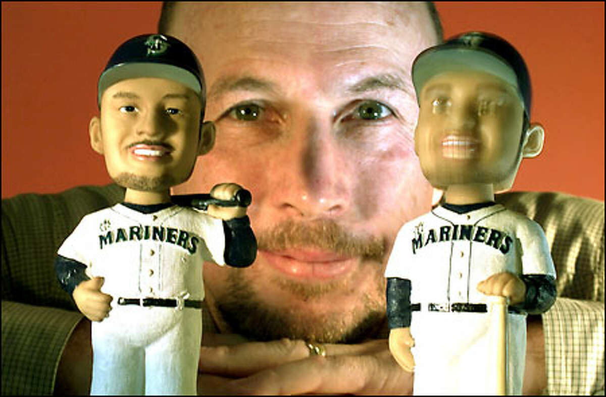 Malcolm Alexander, owner of Alexander Global Promotions, shows off his Ichiro bobblehead dolls. They will be given away to the first 20,000 fans at tomorrow's Seattle Mariners game.
