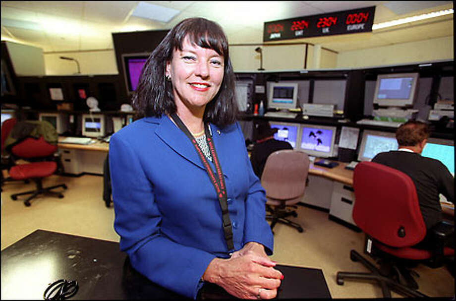 """Laurette Koellner in the Boeing Network Management Center, where her goal is """"always being able to move something forward every single day."""" Photo: Grant M. Haller/Seattle Post-Intelligencer"""