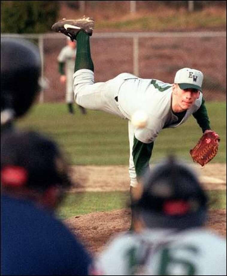 Pitching for Edmonds-Woodway two years ago, Gerik Baxter showed a finishing kick as he released the ball. Photo: Grant M. Haller/1999
