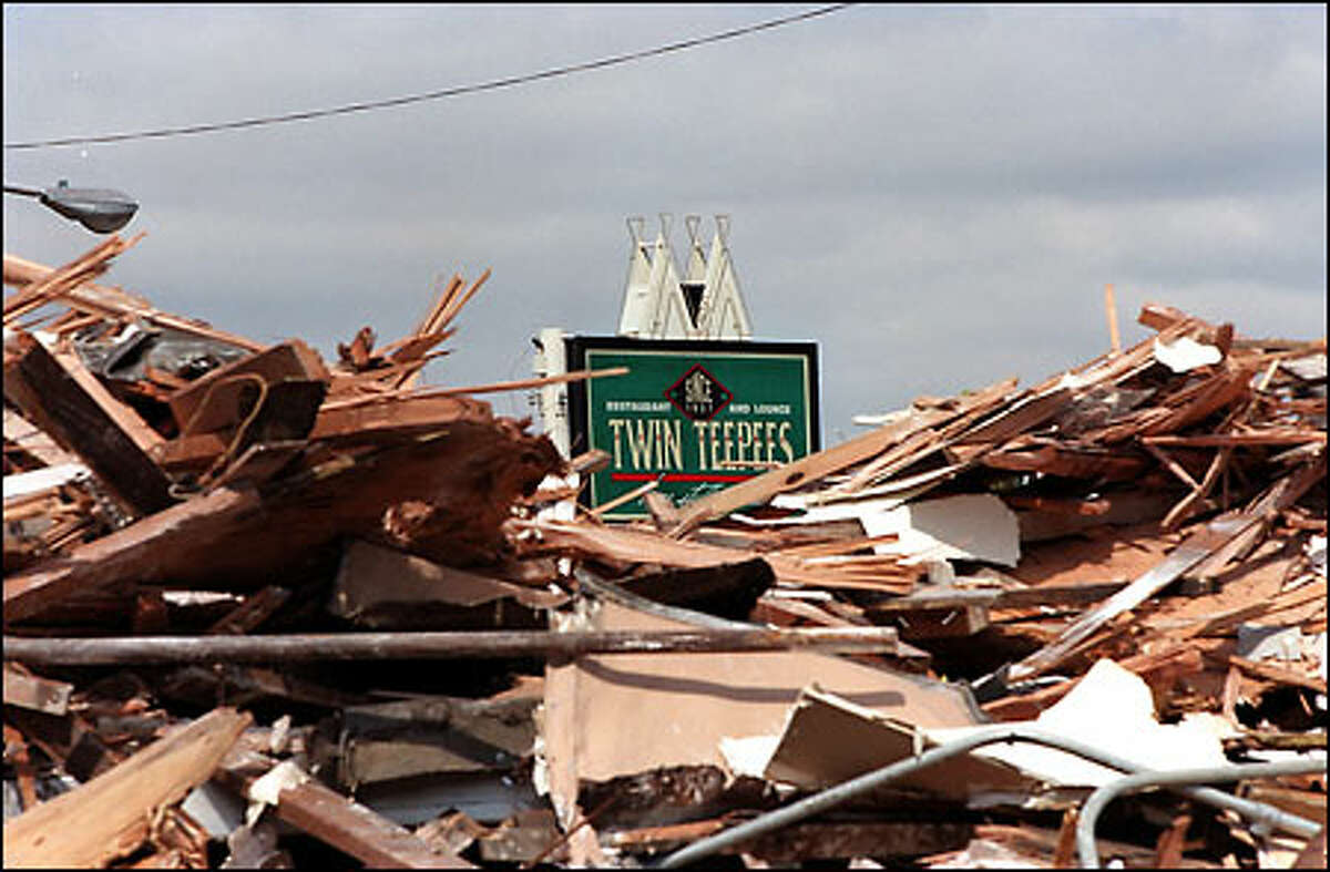 This is all that remained yesterday of the Twin Teepees restaurant on Aurora Avenue North near Green Lake. The building was demolished, and there are no plans to rebuild. The unusual looking restaurant had been closed since May 2000, when it was damaged by fire.