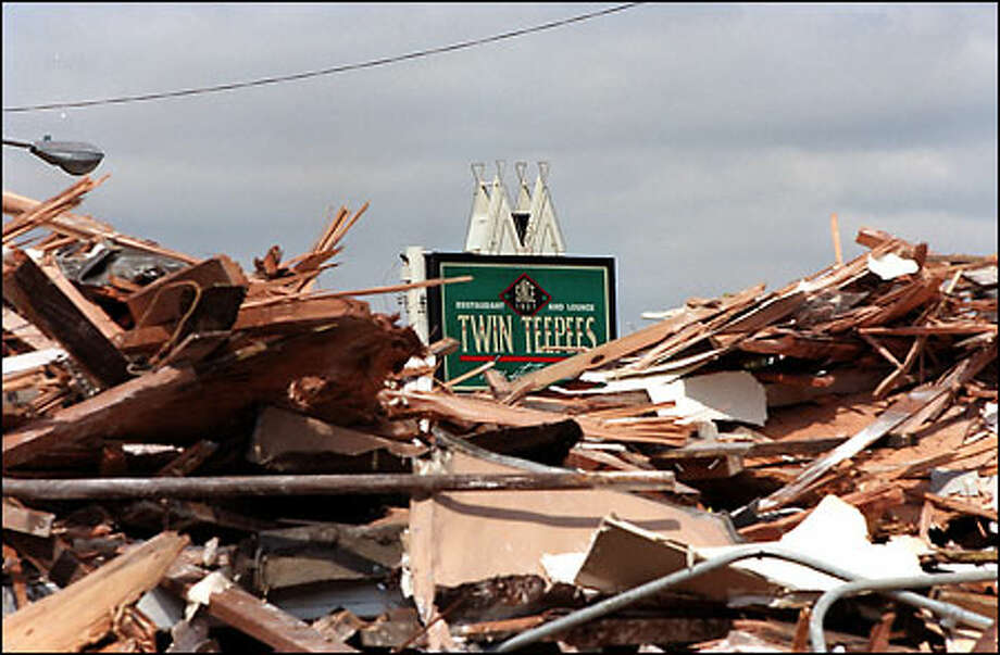 This is all that remained yesterday of the Twin Teepees restaurant on Aurora Avenue North near Green Lake. The building was demolished, and there are no plans to rebuild. The unusual looking restaurant had been closed since May 2000, when it was damaged by fire. Photo: Phil H. Webber/Seattle Post-Intelligencer
