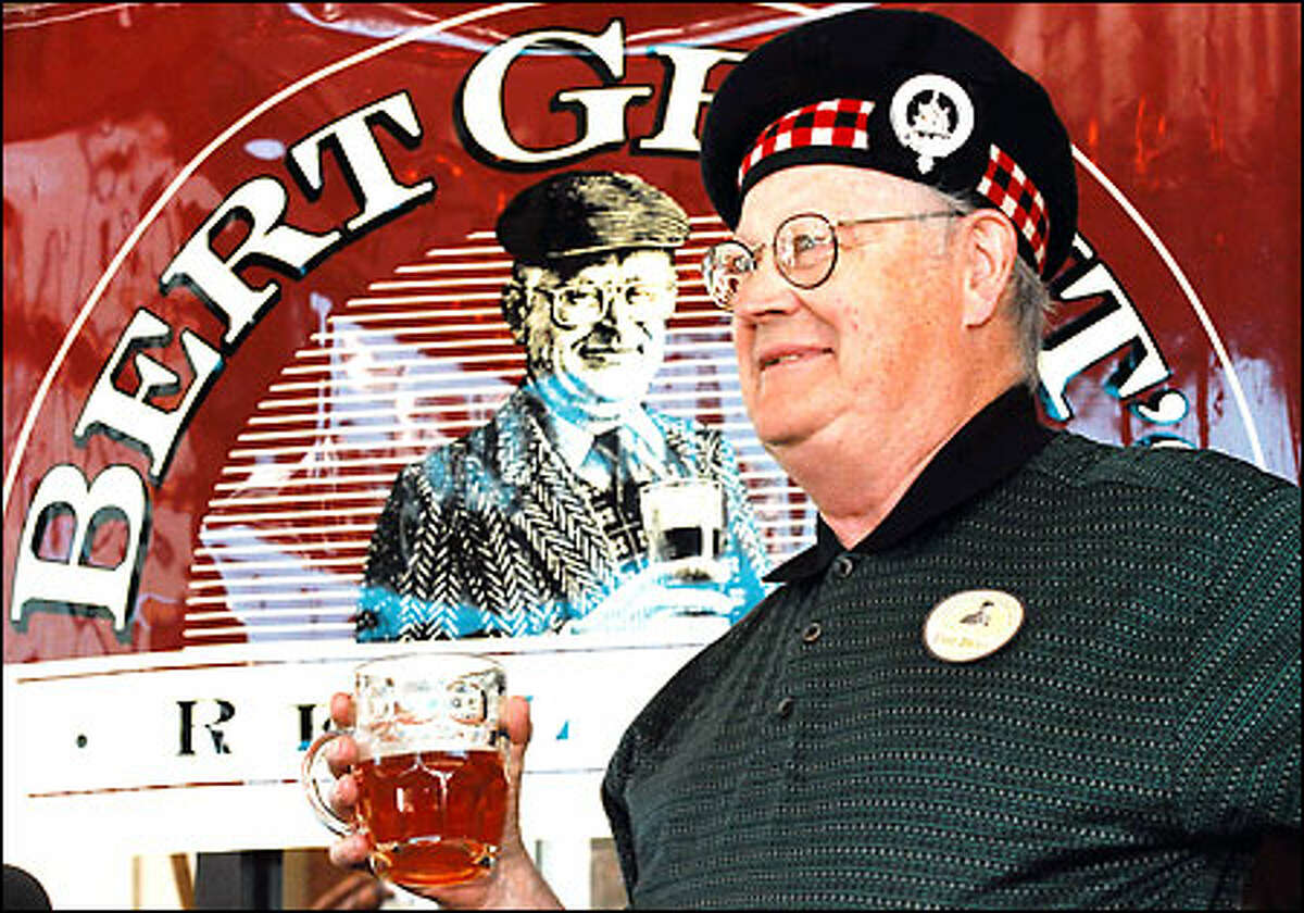 Bert Grant celebrates the 15th anniversary of his Yakima Brewing and Malting Co. in this photo taken at his Yakima brewpub in 1997.