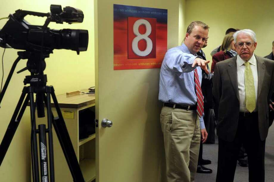 News 8 reporter Jamie Muro shows WTNH's new Fairfield county bureau to Paul Timpanelli, President of the Bridgeport Regional Business Council, March 10th, 2011. Thursday was the first day WTNH broadcast from the bureau in the Connecticut Post newsroom. Photo: Ned Gerard / Connecticut Post