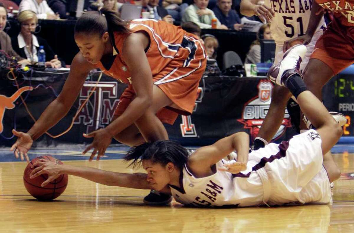 Texas' Yvonne Anderson, top, and Texas A&M's Sydney Carter reach for a loose ball during the second half of an NCAA college basketball game at the Big 12 Conference women's tournament Wednesday, March 9, 2011, in Kansas City, Mo.