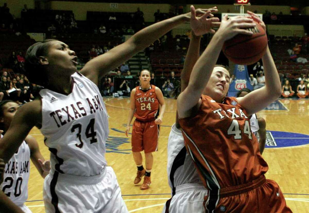 Texas' Anne Marie Hartung, right, pulls down a rebound as Texas A&M's Karla Gilbert, left, defends during the first half of an NCAA college basketball game at the Big 12 Conference women's tournament on Wednesday, March 9, 2011, in Kansas City, Mo.