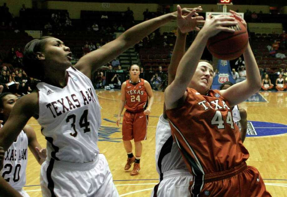 Texas' Anne Marie Hartung, right, pulls down a rebound as Texas A&M's Karla Gilbert, left, defends during the first half of an NCAA college basketball game at the Big 12 Conference women's tournament on Wednesday, March 9, 2011, in Kansas City, Mo. Photo: AP