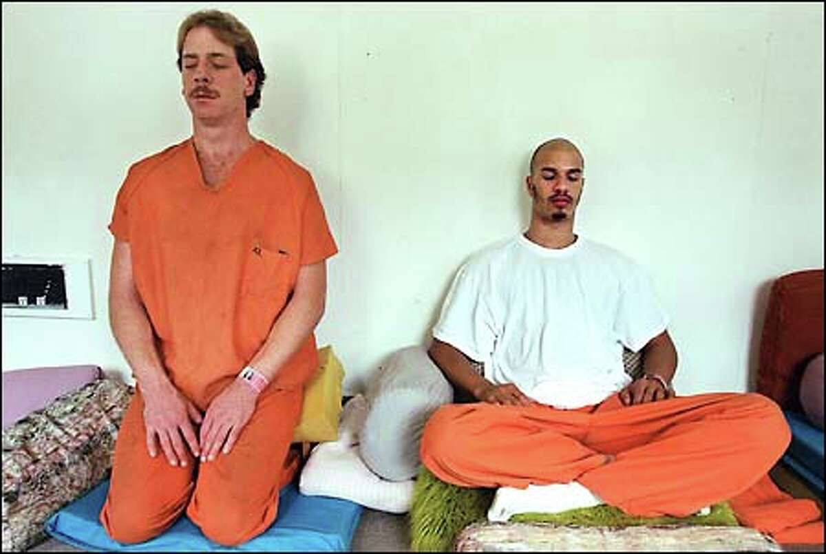 Inmates William Lambert, left, and Steven Marcus practice Vipassana meditation at the Northern Rehabilitation Facility, a minimum-security jail in Shoreline.