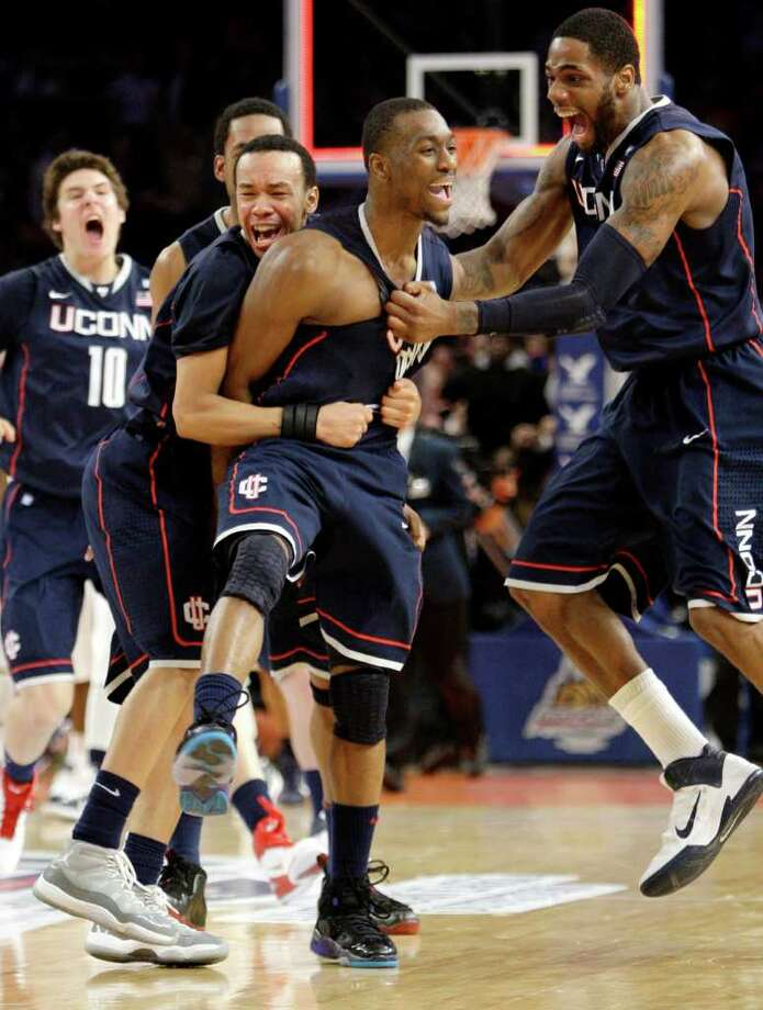 Connecticut's Kemba Walker, center, celebrates scoring the winning goal in the final seconds of the second half of an NCAA college basketball game against Pittsburgh at the Big East Championship, Thursday, March 10, 2011 at Madison Square Garden in New York.  Connecticut defeated Pittsburgh 76-74. (AP Photo/Mary Altaffer) Photo: Mary Altaffer, AP / Associated Press