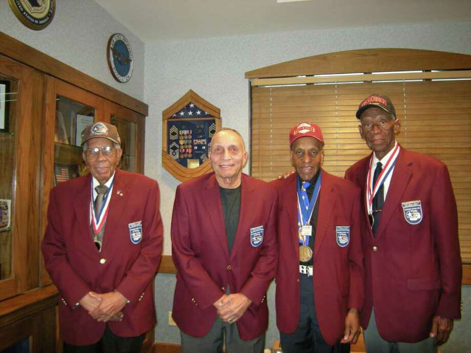 Surviving Tuskegee Airmen (from left) Warren Eusan, Gene Derricotte, Granville Coggs and John Miles continue to meet as the San Antonio chapter of Tuskegee Airmen Inc. Photo: Photo By Wanda Thomas Littles