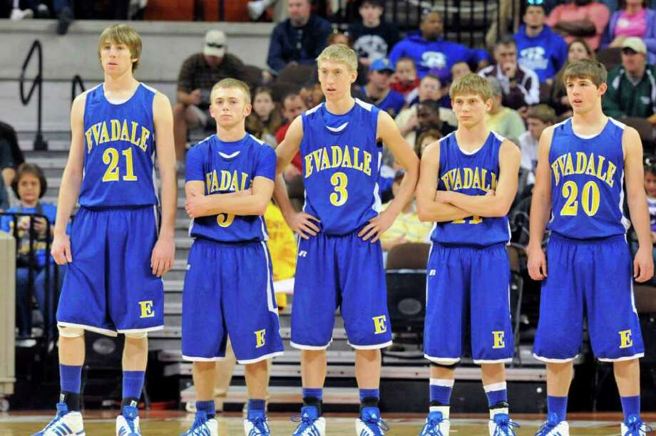 The Evadale boys basketball team stands for introductions at the start of the 1A Division I Region IV semifinal in Austin on Thursday morning.  March 10, 2011.  Valentino Mauricio/The Enterprise Photo: Valentino Mauricio / Beaumont