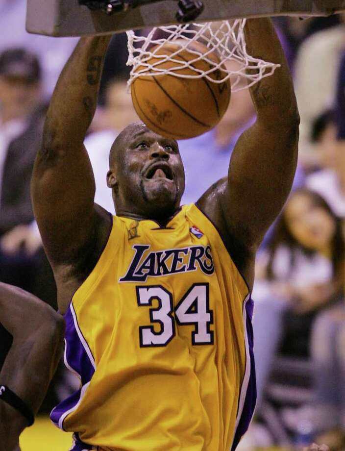 The Los Angeles Lakers' Shaquille O'Neal slam dunks against the Detroit Pistons in the third quarter of Game 2 of the NBA Finals in Los Angeles, Tuesday, June 8, 2004. (AP Photo/Chris Carlson) Photo: CHRIS CARLSON, File Photos / AP