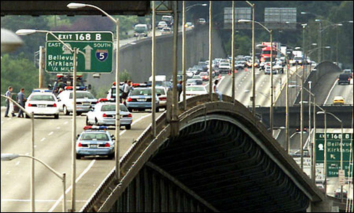 When passing motorists began insulting the woman and encouraging her to jump, Seattle police blocked all lanes of traffic in both directions of the freeway.