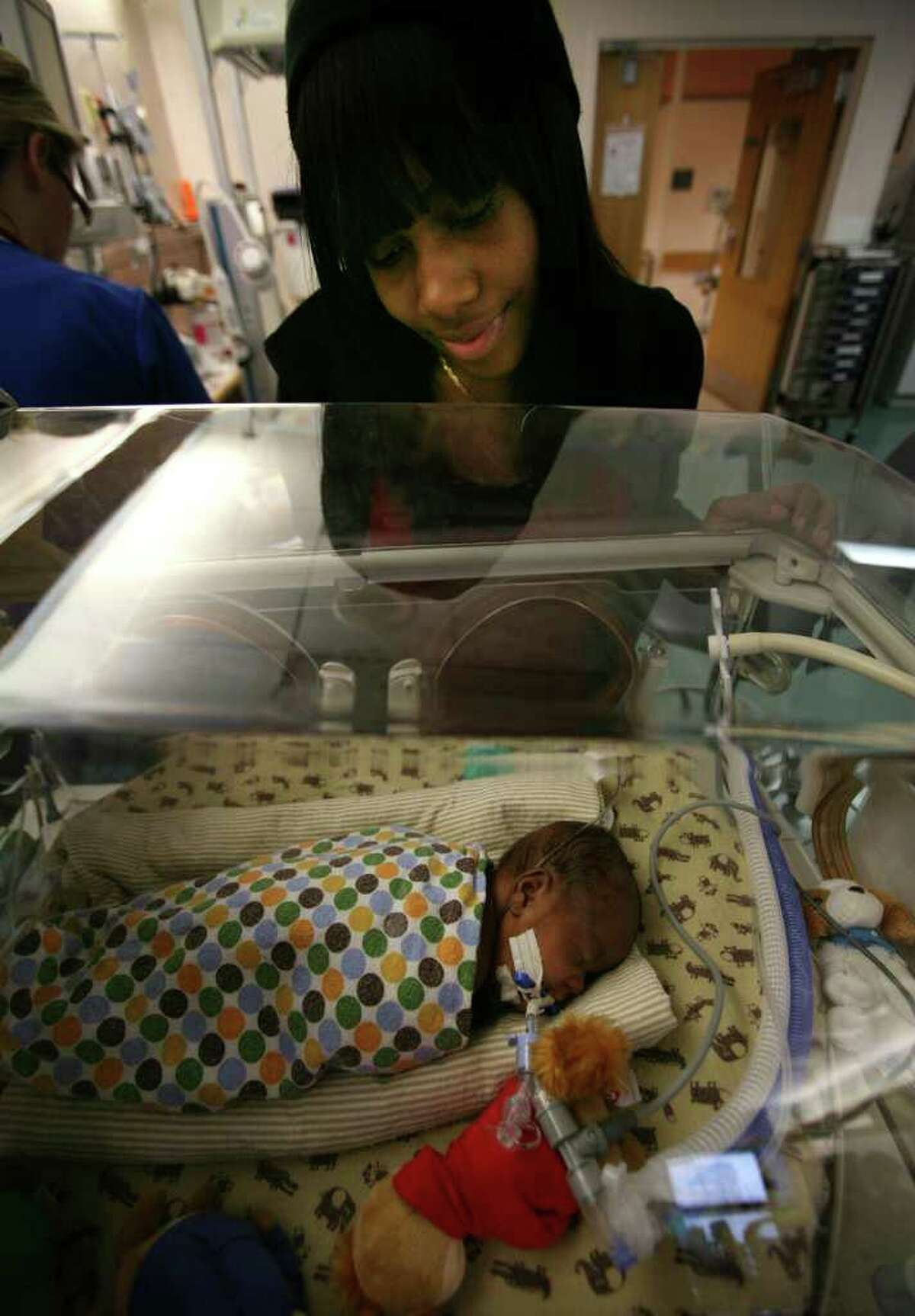 Brittany Bines of Norwalk visits with her son Camren Padgett, 3 months, in the newborn special care unit at Yale New Haven Hospital recently.