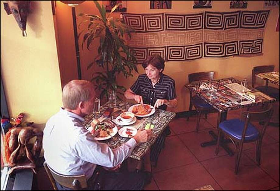 Margaret Hopstein and Charles Neals enjoy an early dinner at Afrikando in Belltown. Photo: JOSHUA TRUJILLO/P-I