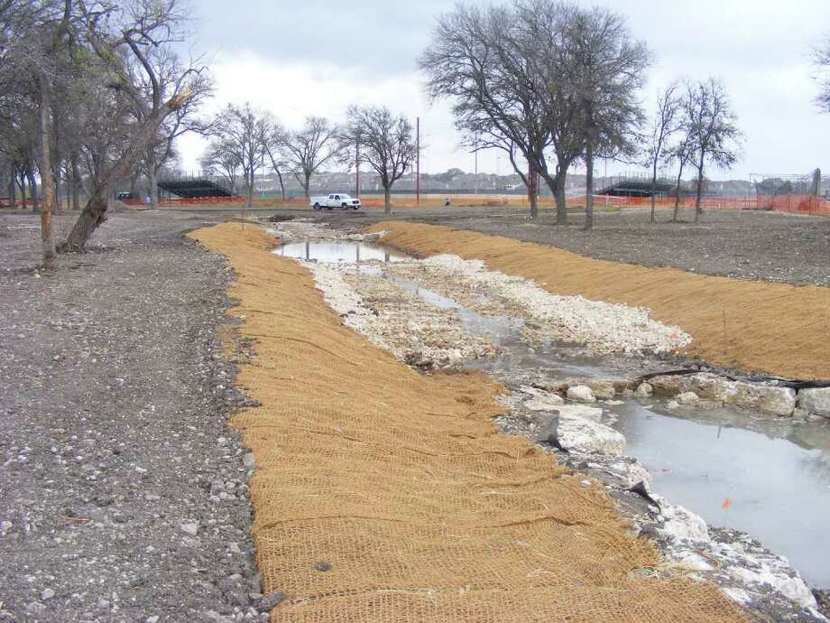 What used to be a winding Salitrillo Creek alongside Judson High School's Performing Arts Center is now a flowing stream, thanks to the San Antonio River Authority. Photo: Photo By Jeff B. Flinn