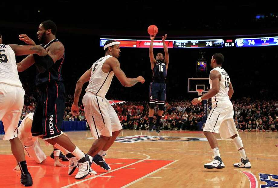 NEW YORK, NY - MARCH 10: Kemba Walker #15 of the Connecticut Huskies shoots a game winning basket against the Pittsburgh Panthers during the quarterfinals of the 2011 Big East Men's Basketball Tournament presented by American Eagle Outfitters  at Madison Square Garden on March 10, 2011 in New York City.  (Photo by Chris Trotman/Getty Images) *** Local Caption *** Kemba Walker Photo: Chris Trotman, Getty Images / 2011 Getty Images