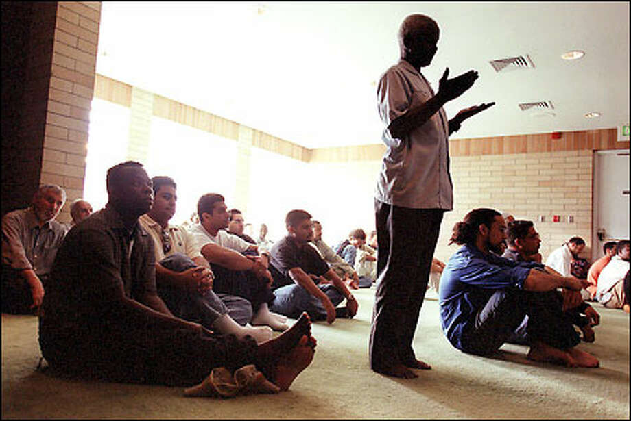 """Afternoon prayers as Members of the Northgate-area Islamic Idriss Mosque in afternoon prayers. """"It means a lot,"""" the mosque's director of operations, Hisham Farajallah, said of the outpouring of support. """"It shows the goodness of the American people and that these are the feelings of the majority. That's what counts."""" Photo: Paul Joseph Brown/Seattle Post-Intelligencer"""