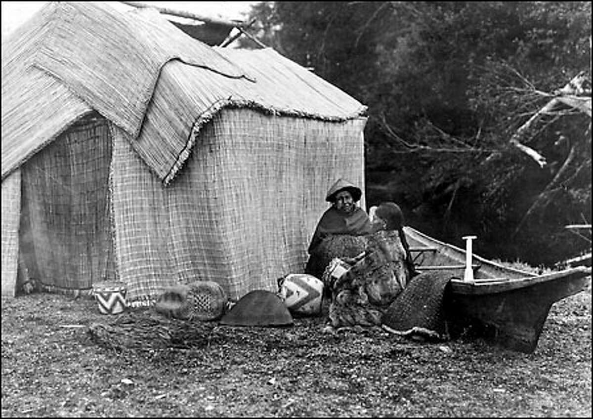 Chief Seattle's people used portable summer shelters, rain gear of woven reeds, and shovel-nosed canoes such as these photographed by Edward S. Curtis.