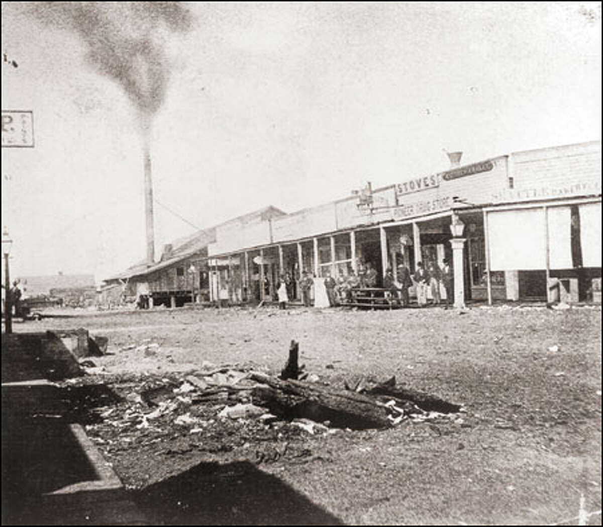 Henry Yesler's sawmill and commercial buildings at Front Street (now First Avenue) and James Street in the 1870s. The mill provided Seattle's first salaried jobs.