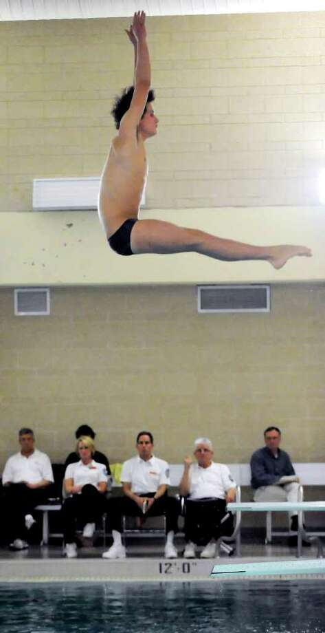 Connor Brisson of Greenwich High School competes in the Class LL Diving Finals at Hamden High School, Thursday, March 10, 2011. Photo: Bob Luckey / Greenwich Time
