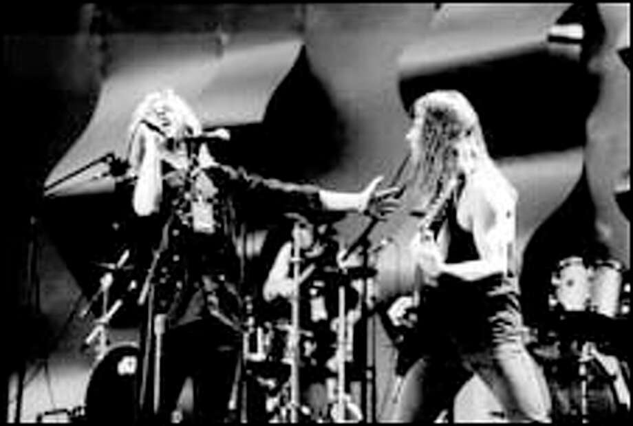 Getting the lead out: TKO lead singer Brad Sinsel, left, guitarist Rick Pierce and company will try to recapture some of that heavy-metal magic in a reunion show tonight at the EMP.