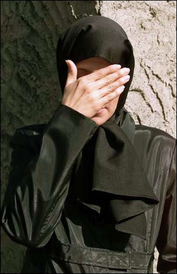 D. Parvaz, wearing a hijaab, hides her face not from embarrassment but because of fears for her safety. Photo: PAUL KITAGAKI JR./P-I