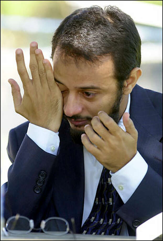 Dr. Al-Badr M.H. Al-Hazmi breaks down while talking about his two-week ordeal. Photo: / San Antonio Express-News