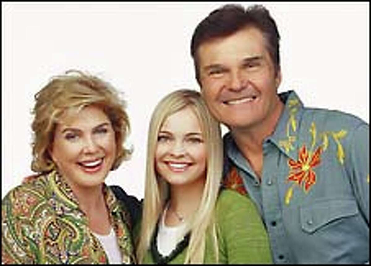 """Molly (Reagan Dale Neis, center) gives a teen's-eye view of her goofy family in """"Maybe It's Me."""" Julia Sweeney and Fred Willard play her parents."""