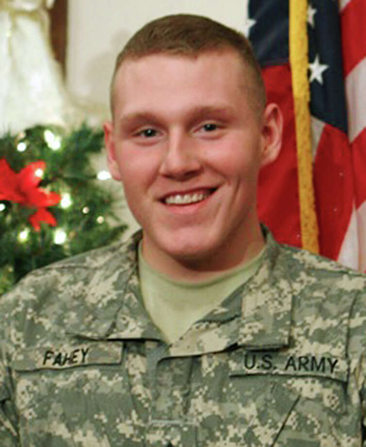 This undated photo provided by the U.S. Army 170th Military Police Company shows Spc. David R. Fahey Jr., 23, of Norwalk, Conn. Fahey died Monday, Feb. 28, 2011 in Afghanistan of wounds from an improvised bomb. The Army said Monday, March 7, 2011, that Fahey had received a posthumous promotion from his previously-held rank of Pfc. to the current rank of Spc. (AP Photo/U.S. Army) Photo: AP