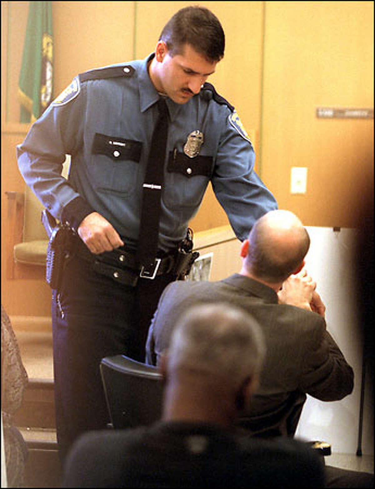 Officer Greg Neubert describes to Deputy Prosecutor Mike Lang how Aaron Roberts grabbed his wrist during the traffic stop that led to Roberts' shooting.