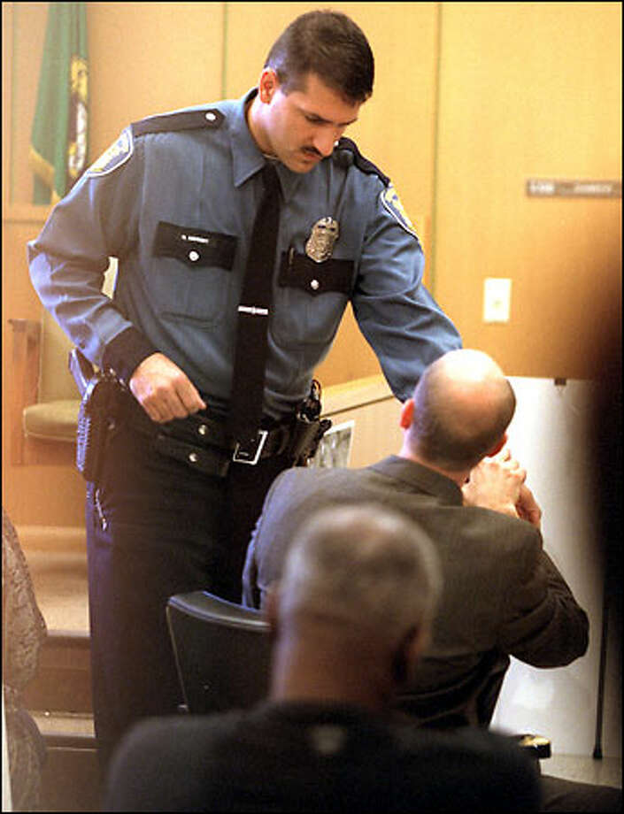 Officer Greg Neubert describes to Deputy Prosecutor Mike Lang how Aaron Roberts grabbed his wrist during the traffic stop that led to Roberts' shooting. Photo: Gilbert W. Arias/Seattle Post-Intelligencer