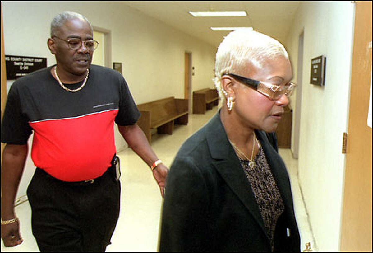 Deloris Roberts and friend Robert Williams head into the courtroom to watch the inquest into the shooting death of Aaron Roberts on May 31.