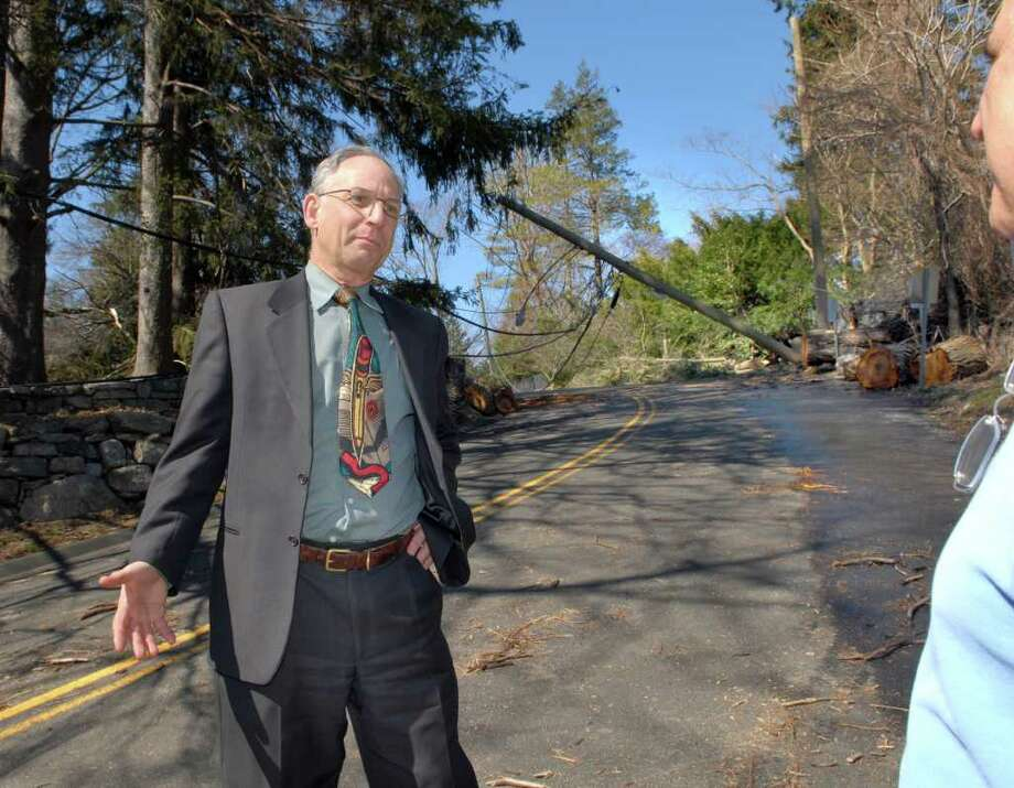 Greenwich Superintendent of schools Sidney A. Freund, left, surveys the damage on Clapboard Ridge Road in Greenwich along with a Ted Milone, right, a representative from Connecticut Light & Power during a bus and walking tour of storm-ravaged areas in Greenwich on March 17, 2010. Photo: File Photo / Greenwich Time File Photo