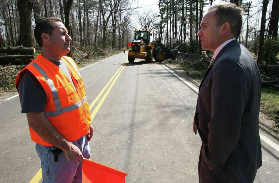 First Selectman Peter Tesei, right, speaks with Greenwich Highway Inspector John Inesta during storm cleanup on Round Hill Road in the days after the March 13, 2010, nor'easter. Photo: File Photo / Greenwich Time File Photo