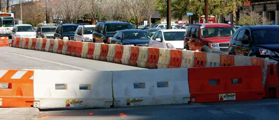 Cars stack up on Broadway near Hildebrand Avenue in March, when the AT&T project began. Next up is an 18-month city drainage and utility project that's tied up in court. Photo: WILLIAM LUTHER, William Luther/Express-News / SAN ANTONIO EXPRESS-NEWS