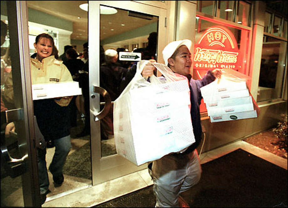 J.R. Dabon, who camped out overnight waiting for Issaquah's new Krispy Kreme store to open at 5:30 a.m., was one of the first customers yesterday. He bought 15 dozen doughnuts. Photo: Paul Joseph Brown/Seattle Post-Intelligencer