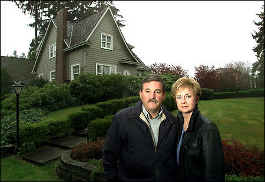 Mike and Patti Bourgault in front of their 70-year-old Snohomish County home. The former farmland around their place is filling with new homes. Photo: Paul Kitagaki Jr./Seattle Post-Intelligencer