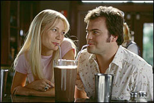 Rosemary (Gwyneth Paltrow) and Hal (Jack Black) share a tender moment over an enormous chocolate shake. Photo: TWENTIETH CENTURY FOX