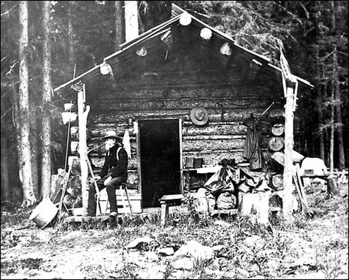 Denny at a cabin used during 1899 construction of a Snoqualmie Pass road.