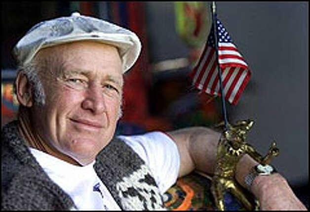 "Writer Ken Kesey poses with ""Newt the Nut Catcher hood ornament on his second bus called Further at his farm near Pleasant Hill, Ore. Photo: THE ASSOCIATED PRESS/2000"