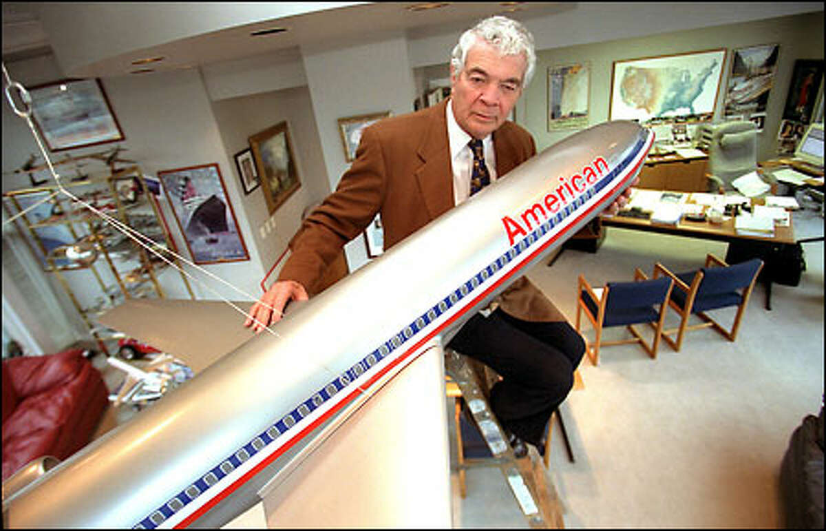 James Raisbeck, CEO of Raisbeck Engineering, in his Seattle office with one of several model planes he collects. His innovation in aircraft design features has become legendary.