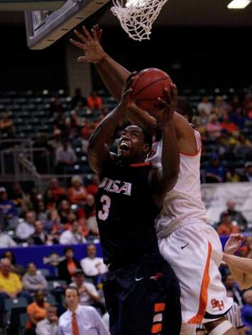 UTSA's Larry Wilkins  drives past SHSU's Antuan Bootle during a basketball game between UTSA and SHSU at the Southland Conference Tournament at the Merrell Center in Katy, Texas. Photo: Bob Levey / Freelance