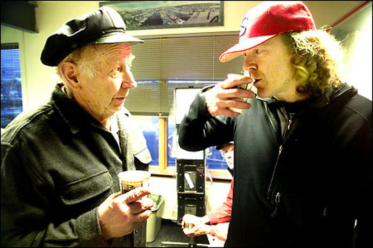 Activist Pete Knutson, right, chats with 83-year-old Boyd Dingman at the Port of Seattle's Fishermen's Terminal office.