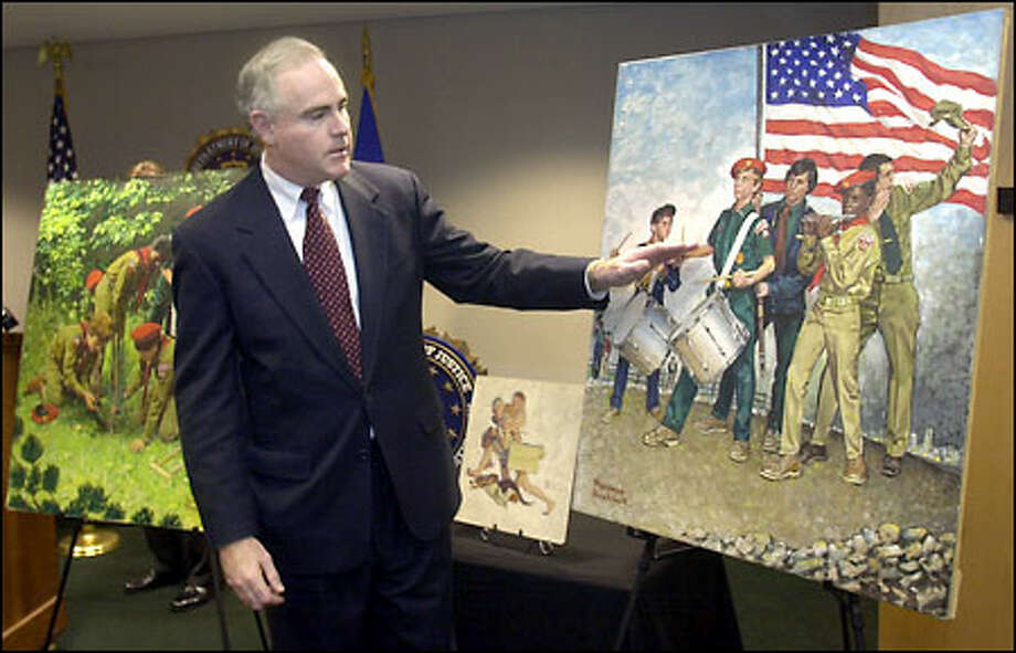 "U.S. Attorney Patrick Meehan shows three recovered Norman Rockwell paintings. From left, they are ""So Much Concern,"" ""A Hasty Retreat"" and ""Spirit of '76."" They were among seven stolen from the Elayne Galleries in Minneapolis during an exhibition in 1978. Photo: / Associated Press"