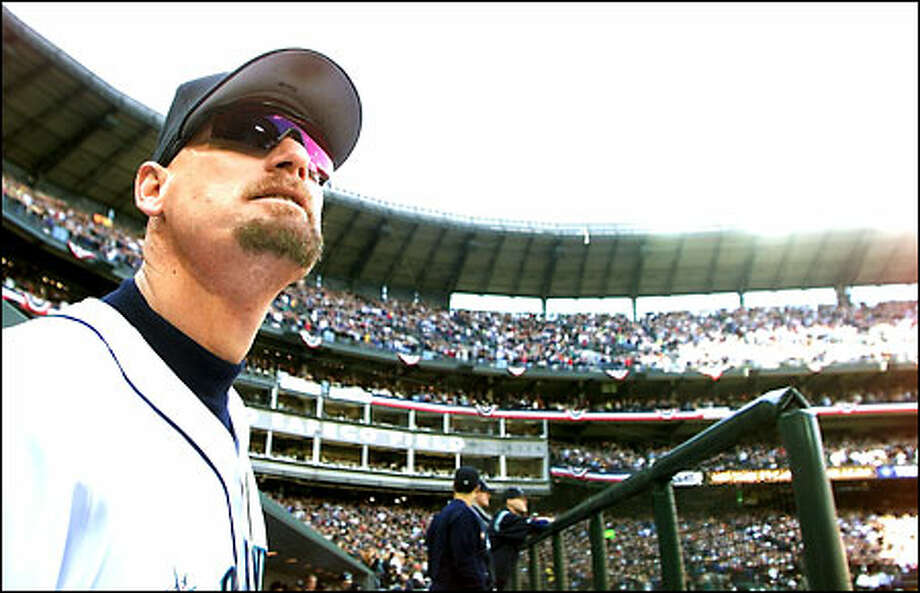 Jay Buhner, who will announce his retirement today after playing with the Mariners since 1988, gazes out onto Safeco Field before Game 5 of the AL Division Series against the Indians. Photo: Dan DeLong/Seattle Post-Intelligencer