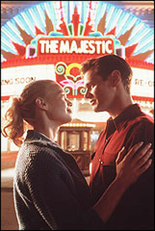 "Peter Appleton (Jim Carrey) is led to believe he's war hero Luke Trimble and that Adele Stanton (Laurie Holden) is Luke's high school sweetheart in ""The Majestic."" Photo: RALPH NELSON"