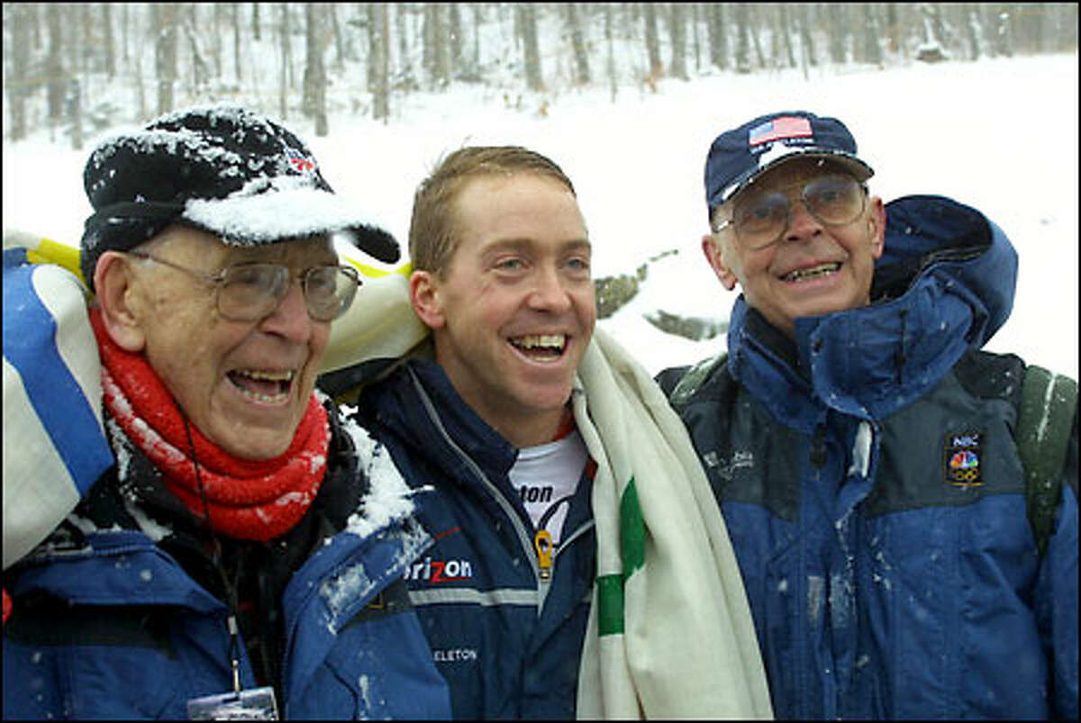 Jim Shea Jr., center, stands with father Jim Shea Sr., right, and grandfather, Jack Shea, after securing a berth on the U.S. Olympic team at the World Cup skeleton competition in December 2001.