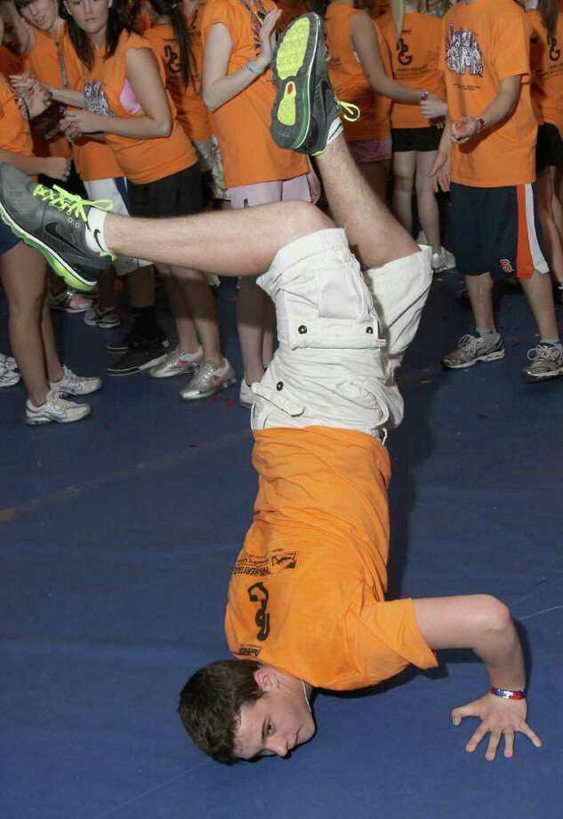 Bradly Brean shows off some of his break dancing skills during the South High Marathon Dance to benefit individuals, families and organizations in need of financial assistance. Glens Falls, N.Y., March 4, 2011 (Photo by Joe Putrock / Special to the Times Union) Photo: Joe Putrock / Joe Putrock