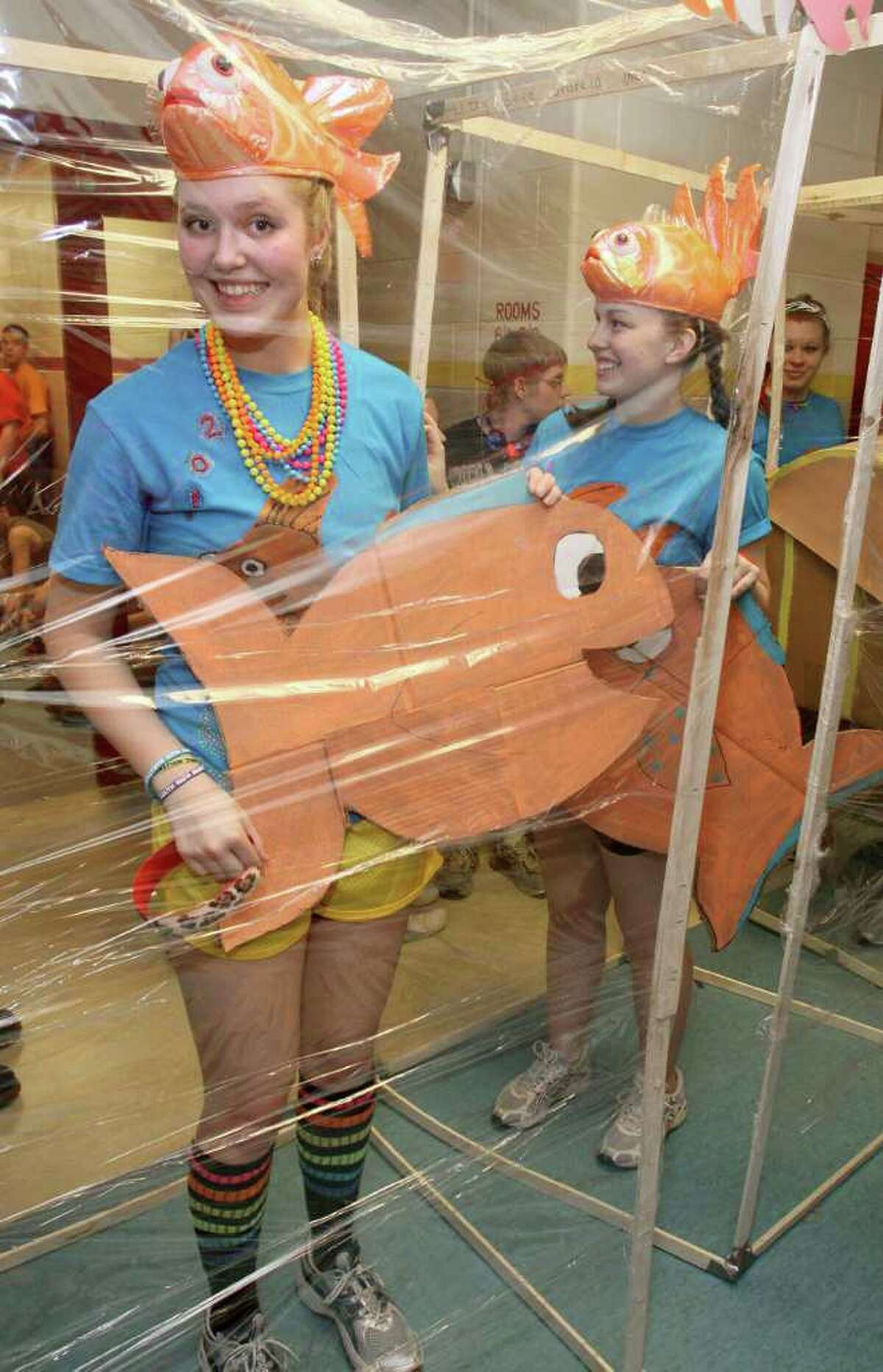 Sara Wells, left, and Devin Smith dressed as fish in a tank made of cellophane for the costume contest. Glens Falls, N.Y., March 4, 2011 (Photo by Joe Putrock / Special to the Times Union)