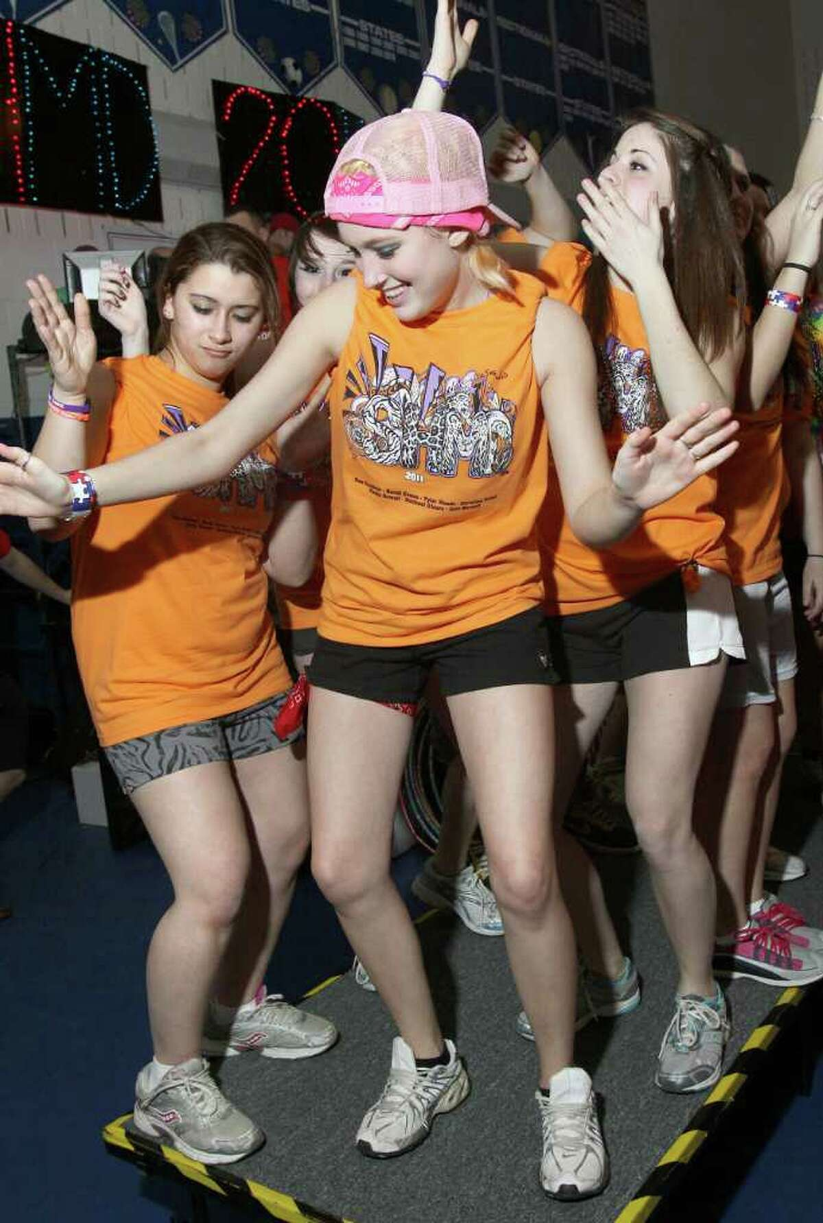 Destiney Derush, center, Ana Polito, left, and Elisa Sutphin dance on a platform during the South High Marathon Dance. Glens Falls, N.Y. March 4, 2011 (Photo by Joe Putrock / Special to the Times Union)
